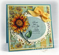 """The Bring Back Beautiful Team decided to focus on Creating something from the garden. Kathy Jones created this stunning sunflower card. For her creation she used Flourishes stamp set """"Sunflowers"""" She also used some of Flourishes products such as Floral Oval Nestabilities die, Memento Tuxedo Black Ink, Copic Collections in Sunflower, Leaf Green, Dahlia, Beehive, Flesh Tones, and the Bow Easy. Be sure to check out Flourishes for the items, and her blog for more details."""