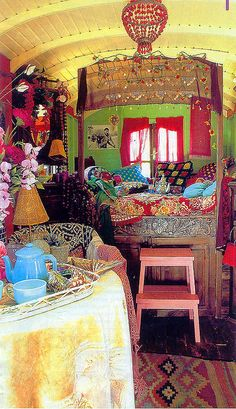 Interior of a gypsy vardo - love the colors and textures