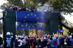 MEDINAH, IL - SEPTEMBER 30:  Players and caddies from team Europe celebrate after Europe defeated the USA 14.5 to 13.5 to retain the Ryder Cup during the Singles Matches for The 39th Ryder Cup at Medinah Country Club on September 30, 2012 in Medinah, Illinois.