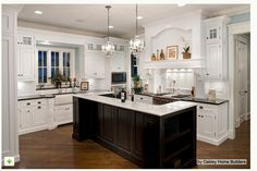 2 smaller chandeliers... cute idea for over a kitchen island! Expert Talk: 10 Reasons to Hang a Chandelier in the Kitchen