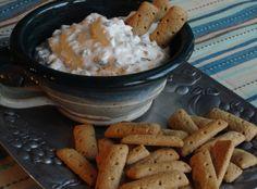 *Buckeye Dip Recipe* 4 ozcream cheese 1/2 cpeanut butter, creamy 1/8 cmilk 1 c confectioners' sugar 8 ozcool whip 12 oz mini chocolate chips graham cracker sticks