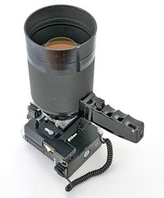 Nikon F36 motor drive with cordless battery pack, 50cm f5 reflex mirror lens and the optional handgrip with coiled connecting cord.