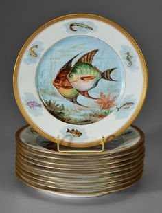 "A set of ten Limoges porcelain fish plates, hand painted central madallions with various species of saltwater fish and underwater plants surrounded by six marine animals. Marke ""F LeGrand & Cie Limoges, France,"" circa 1901-1950"