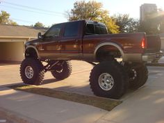 "King ranch on 54"" michelins ford powerstroke - He needs a bigger garage!"