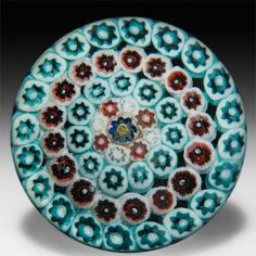 Salvador Ysart concentric millefiori greens and ochres glass paperweight. by Paul Ysart