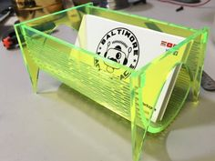 Laser cut acrylic business card holder. Uses a living hinge cut for bottom.