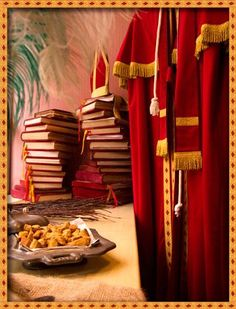 St. Nicholas's books with the names of good boys and girls. Traditional Sinterklaas outfit, cute image!