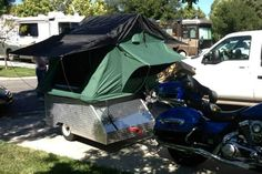 Sure, motorcycles and Compact Camping go together. Nice example of lightweight Tent Topped touring bike sized DIY Camping trailer