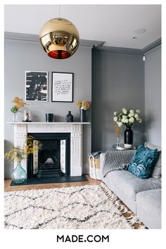 Light-filled spacious living room with large monochrome rug and metallic round pendant. Step inside the South West London Home of Sommer Pyne to see more interior inspiration. Grey Walls Living Room, Living Room Color Schemes, Spacious Living Room, Living Room Paint, Living Room Colors, Living Room Grey, Rugs In Living Room, Living Room Decor, London Living Room