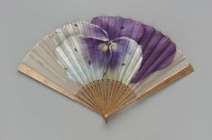 Pansy fan | Museum of Fine Arts, Boston Pansy fan (1885–1910). Fan with painted silk gauze leaf. Large pansy with five bees, painted by Grace E.A. Ford (1885) For Allen Fan Company.  Image and text courtesy MFA Boston.