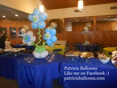 Balloon Flower and Pacifier Centerpieces made by, Patricia Balloona, http://patriciaballoona.wordpress.com/2014/10/05/402nd-and-403rd-balloon-sculptures-pacifier-and-flower-centerpieces/