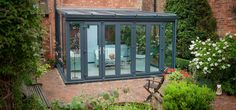 small lean to extension with lead roof – Bing images - Beleuchtung Conservatory Playroom, Lean To Conservatory, Conservatory Extension, Glass Conservatory, Conservatory Design, Curved Pergola, Pergola Lighting, Pergola Shade, Windows