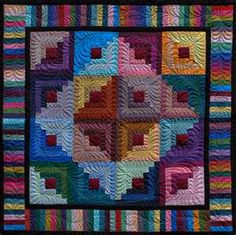 An Amish family makes a log cabin quilt to raise much-needed funds for ...