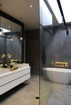 large mirror + skylight + frameless glass shower screen