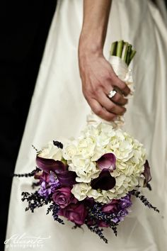A pretty hydrangea with purple accents from a lavender themed wedding.  Bouquet by The Petal and The Stem.