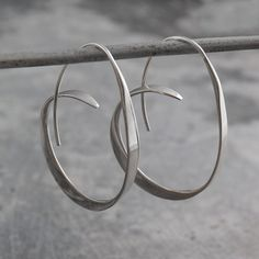 Silver Hoop Earrings, Silver Earrings, 925 Silver Earrings, Hoops - Silver Hoops, Unusual Hoop Earrings, Large Hoops, Modern Hoop Earrings A unique take on the traditional hoop, these earrings will definitely get noticed. Gradually tapered and flared, these silver hoops look wonderful and are easy to wear, too! Made from Sterling Silver. Dimensions: Earrings length: approx. 3.8cm Earrings width: approx. 0.3cm Like this Product? Take a look at these: Silver Ribbon Curl Hoop Earrings…