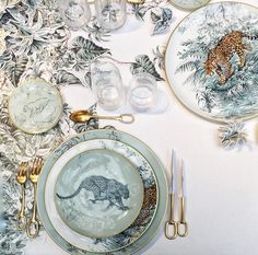 into the wild with hermés' homage to artist robert dallet. his studio comes alive at the table with every leaf, fur and feather detail translated onto the intricate collection of porcelain.