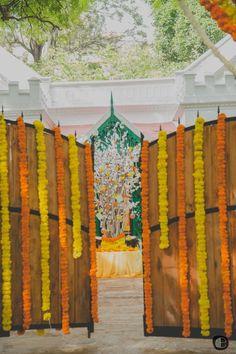 decor on gates, entrance decor, genda phool decor, yellow and orange floral…