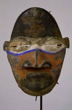 Mask  Late 19th/early 20th century  West Africa, Ivory Coast or Liberia  Wood, metal, quills, pigment  h. 21.6 cm  UEA 211