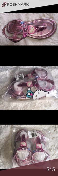🌸 Hello Kitty Bling Sandals 🌸 Brand New! Brand new Hello Kitty Sandals bought from Khol's. bought 2 pairs for my daughters but they just shared one pair and grew out of them. I added a picture of the used one to show detail out of package. So cute!!! PRICE IS FIRM ON THESE AND NO TRADES Hello Kitty Shoes Sandals & Flip Flops