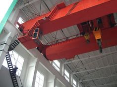 Overhead bridge cranes are versions of the crane that lift objects by a hoist, which is fixed in a trolley and can move about horizontally on a rail or pair of rails fixed under a beam. Overhead cranes, also known as bridge cranes, have the ends of the underneath supporting beam on wheels running on rails at elevated level, usually on the parallel side walls of a factory or similar huge industrial building.