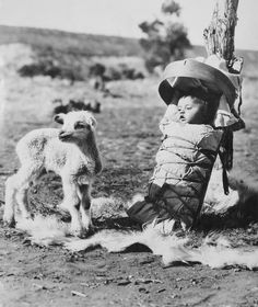 Navajo Papoose on a Cradle-Board with a Lamb Approaching
