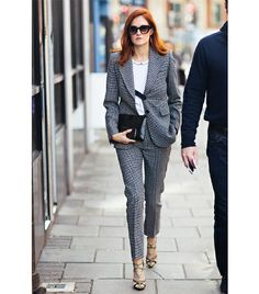 Taylor Tomasi Hill  The reigning street style queen shows us how to temper the seriousness of a sharp suit with a relaxed tee and statement heels.