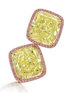 A pair of coloured diamond ear clips by Nirav Modi. Each set with a modified cushion-cut fancy yellow diamond, weighing approximately 31.17 and 30.63 carats, within a circular-cut pink diamond surround, to the circular-cut yellow diamond gallery and clipback, mounted in 18k gold.