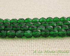 6mm Emerald Green Czech Fire Polished Rounds by AlaModeBeads