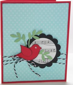 This card is just waiting to sing a Christmas song to someone special.    Card base is Stampin Ups Real Red card stock. Card is made with