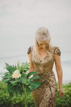 Sparkly gold sequin wedding gown // Tropical Glamour: Nicholas and Skye's Wedding at the Istana, Bali