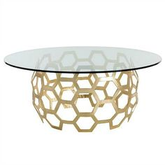 Designer Windsor Smith inspires us with the unpretentious elegance of the round Dolma Entry Table. Produced by Arteriors Home, this piece showcases a circular basket weave pattern of highly polished gold leaf finished hexagons. With the seventy two inch glass top, this exceptionally luxe furniture sets a nonpareil stage in the foyer or lobby for guests!
