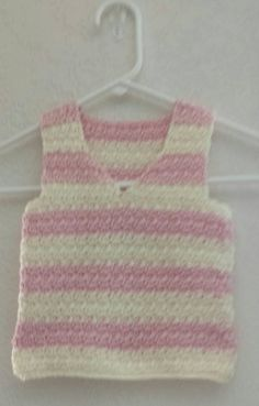 Cute soft pink and off white hand crocheted pullover vest, tank top, sleeveless sweater. Perfect for play time or dress up. It will look great over a t shirt or a button up colored shirt.  Ready to ready!!!   Measures approx 21 1/2 around and 12 in length. Hand crocheted with 100% acrylic Caron yarn.  Please hand wash and lay flat to dry.  Handmade with love and care in a smoke free & pet free home.