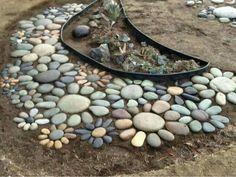 piedras de río y suculentas