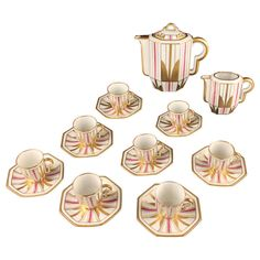 Exceptional and very rare modernist, high class Art Deco gilded coffee or mocca set manufactured by the ULIM porcelain manufacture in Limoges, circa 1925-1928.