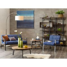Fill your home with retro charm with this Steller Metal Lounge Chair by Ink and Ivy. Constructed with a gunmetaltone metal frame and blue upholstery, this lounge chair is stunning and elegant.