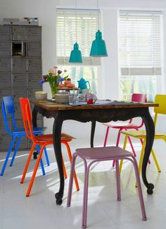 Small Dining Room with Dining Table and Colored Dining Chairs