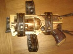 How to Make A Leather Holster - I like this one because you can still see your fancy steampunk gun while wearing it :)