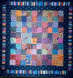 """Fractured Log Cabin""  2000  36"" x 36""  Cotton  Machine Pieced/Quilted  Private Collection/ Allentown, PA  This pattern is an original by Kaffe Fassett. I have re-visited it several times. There are two more quilts I have made, based on this pattern. One is titled ""Pink Lemonade"" and the other ""Wonky Log Cabin."""