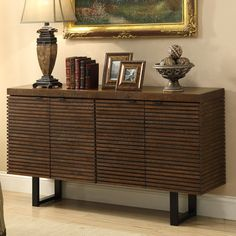 Accented by open metalwork legs, this routed credenza combines eye-catching appeal with convenient storage, featuring ample shelving behind 4 doors.