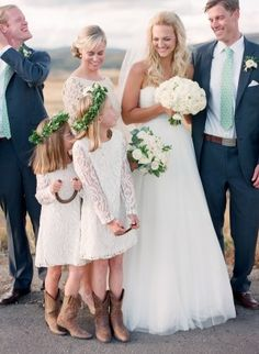 flower girls in cowgirl boots and white laced dresses for a ranch wedding- photo by Laura Murray Photography
