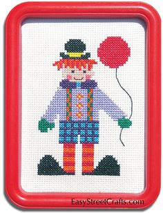 """CIRCUS CLOWN --57CB -- A little shy but very cute.  Would you like to have my balloon? A red 5""""x 7"""" Hoop-Frame, 11-ct Aida cloth and all materials needed for stitching and framing.  EasyStreetCrafts.com"""