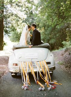 bride and groom in a wedding car.