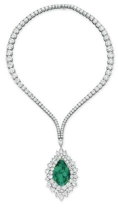 An emerald and diamond pendant necklace, by Harry Winston.