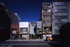 Jyu-bako by Atelier TEKUTO. The site locates at the middle of downtown in Tokyo, surrounded by buildings and residences, is a small plot of land of 90 square meters, faces the road of 23m named Kasuga St. The client requested to have a restaurant and parking spaces at the first floor, and living space for 10 relatives at the second and third floor. He prefers antique than modern and decorative product, and didn't mind working for finishing part of the construction to cover the building cost.