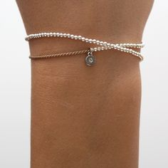 Pure sterling silver beads on beige silk cord. The beads are moveable on the silk thread. logo charm contains a tiny diamond. Silk Thread, Silver Beads, Cord, Beige, Pure Products, Sterling Silver, Diamond, Bracelets, Collection