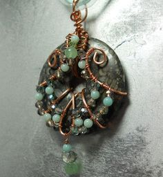 Wire Wrapped Fossil stone donut with green by SilkenTreasures