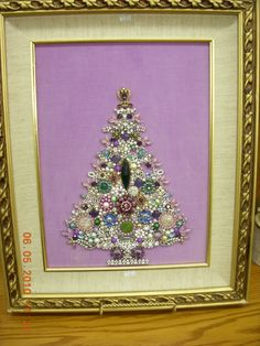 christmas tree made out of old vintage costume jewelry
