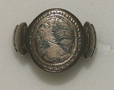 Love ring Italy 15th century Silver ring, the flat oval bezel with a female bust and a flower in niello, the convex hoop shaped as clasped hands with an imitation of sleeves decorated with niello on the shoulders 17.93 mm internal ring diameter; 8.68 g weight
