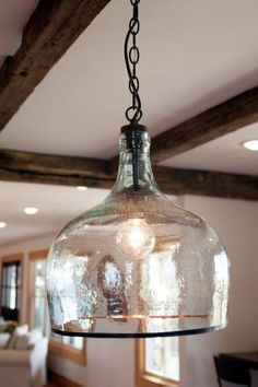 Pendant lighting was added in the kitchen of the Zan family's newly remodeled home, as seen on Fixer Upper. lighting Fixer Upper: A Family Home Resurrected in Rural Texas Farmhouse Pendant Lighting, Farmhouse Light Fixtures, Rustic Lighting, Industrial Lighting, Home Lighting, Lighting Design, Lighting Ideas, Industrial Style, Club Lighting
